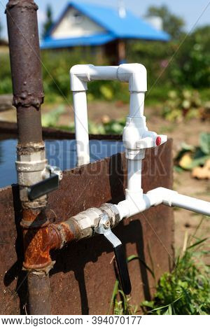 Connection Of Plastic Pipes To The Pump And Water Storage Tank. Pumping Water Using A Homemade Plumb