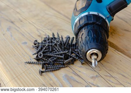 The Concept Of Repair And Construction Of Wooden Structures And Fasteners With Screws. In The Frame,