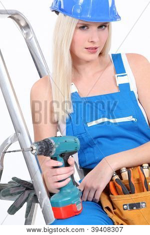 Tradeswoman posing with her tools