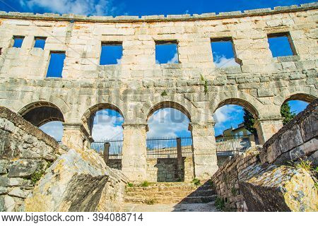 Ancient Heritage In Pula, Istria, Croatia. Arches Of Monumental Roman Arena.