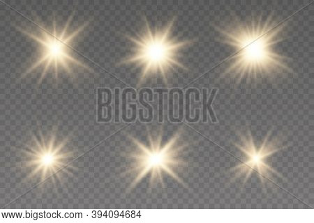 Set Of Gold Bright Beautiful Stars. Light Effect Bright Star. Bright Flashes. Beautiful Light On The