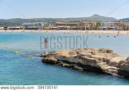 Waterside View To The Sandy Beach Of Javea Or Xabia At Summertime. Spanish Touristic Place. Costa Bl