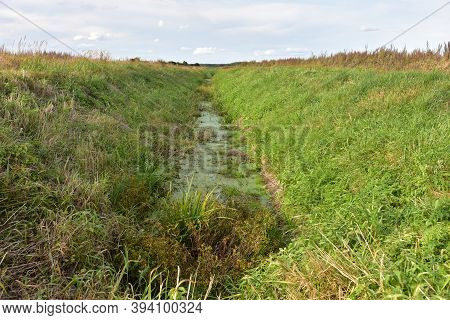 Parched River. Ecology And Environment Problem Concept. Global Warming And Lack Of Rain