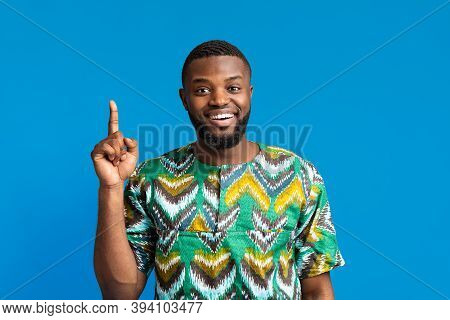 Young African-american Man In Traditional Costume Having Great Idea, Pointing Finger Up, Got Problem