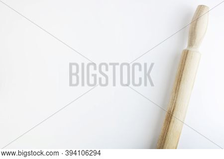 Wooden Rolling Pin For Rolling The Dough Isolated On White Background, With Shadow. Horizontally. Co