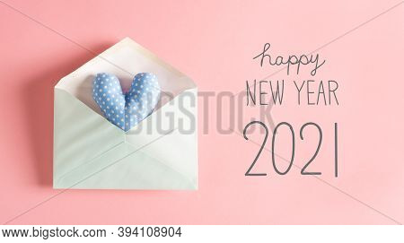New Year Message With A Blue Heart Cushion In An Envelope