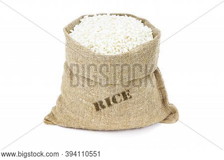 Arborio Rice In Sack Isolated On A White Background. White Rice In Burlap Sack. White Rice In Jute B