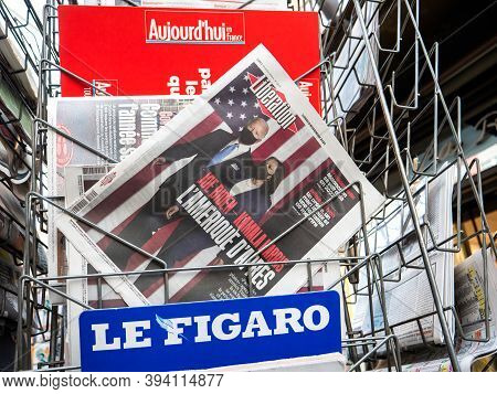 Paris, France - Nov 9, 2020: Low Anglew View On Street Of Liberation Newapaper At Press Kiosk With J