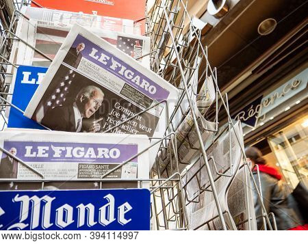 Paris, France - Nov 9, 2020: Multiple Le Figaro Newspaper Press Kiosk With Featuring Confident Joe B