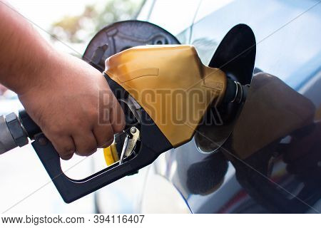 People Who Refuel At A Gas Station - Refueling The Machine A Car Fills Up With Gas At A Gas Station