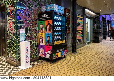 London - November 1, 2020: A Pedestal Hand Sanitiser Next To A Face Mask Vending Machine In Carnaby