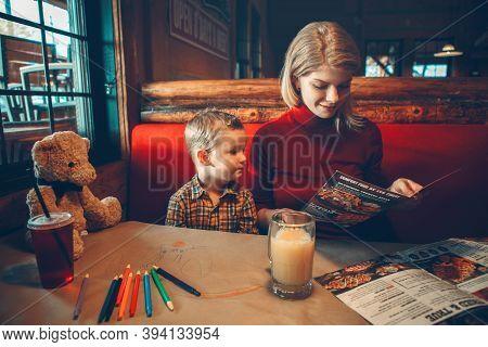 Toronto, Ontario, Canada - November 3, 2019: Young Caucasian Mother And Toddler Boy Son Choosing Mea