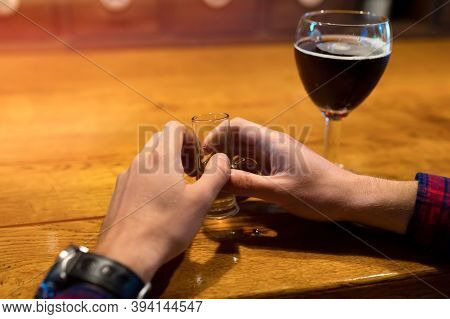 The Concept Of Alcoholism, The Fight Against Alcohol Addiction, Crisis, Depression. Alcohol In Hands