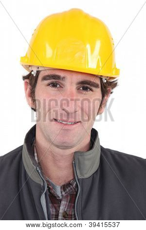Portrait of a worker with yellow helmet
