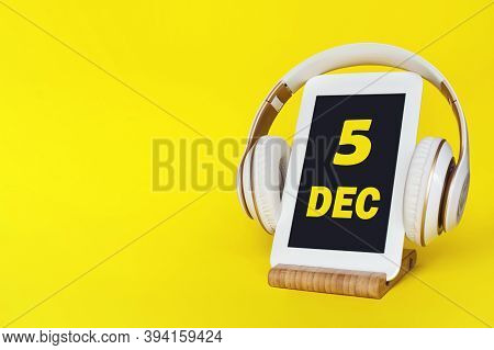 December 5th. Day 5 Of Month, Calendar Date. Stylish Headphones And Modern Tablet On Yellow Backgrou