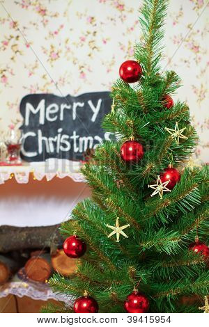 Christmas And New Year Tree, Tablet With An Inscription Merry Christmas, Firewood