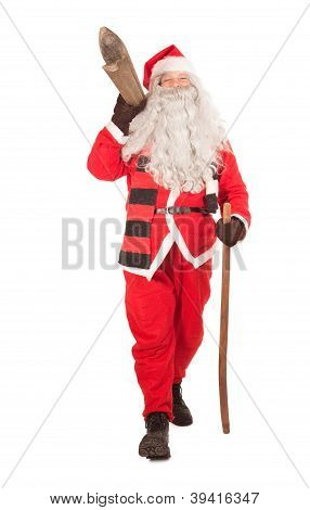 Happy Santa Claus carries skis