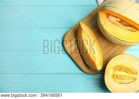 Tasty Fresh Melons On Light Blue Wooden Table, Flat Lay. Space For Text