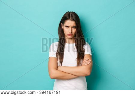 Image Of Upset Sulking Girl, Feeling Offended Or Jealous, Cross Arms Chest And Frowning Angry, Stand