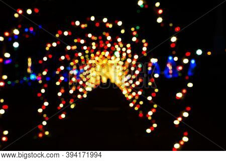 A Christmas Lights Tunnel Of Arches Intentionally Blurred For An Abstract Effect