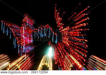 An Abstract Representation Of An Outdoor Christmas Lights Display, Formed By Rapid Camera Movement