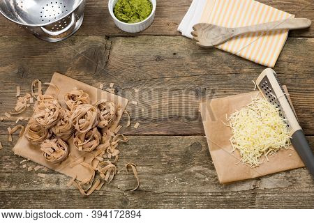 Wholemeal Pasta Tagliatelle Type Prepared For Cooking. Cheese, Wild Garlic And Wall Nut Homemade Pes