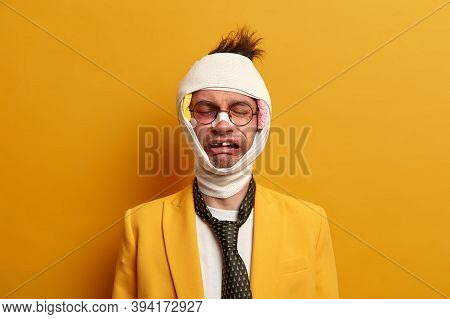 Upset Man With Beaten Up Face Expresses Hurtful Pain, Cries From Despair, Has Broken Teeth, Wears Me