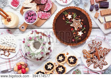 Assorted Christmas Holiday Desserts And Sweets. Top View  Table Scene Over A White Wood Background.