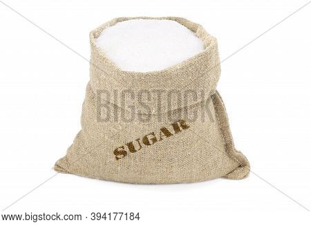 Sugar In A Sack Isolated On A White Background. White Sugar In Burlap Sack. Sugar In Jute Bag