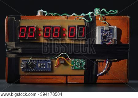 Bomb With Red Timer On Black Background. Improvised Explosive Device. Terrorist Threat. Dynamite Wit