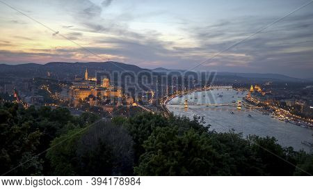 View Of The Of Buda Castle, Chain Bridge And Danube River At Sunset From Citadella In Budapest