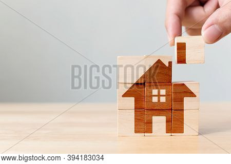 Property Investment And House Mortgage Financial Real Estate Concept. Wooden Cube Block Puzzle With