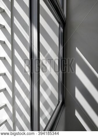Selective Focus At Glass Window Sill, Side View And Diagonal Pattern Of Sunlight And Shadow Shining