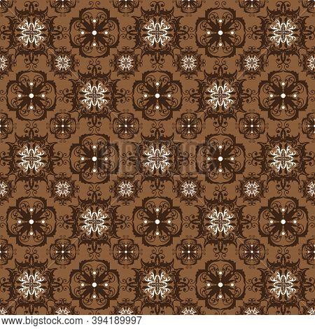 Unique Flower Patterns On Bantul Batik With Simple Dark Brown Color Design.