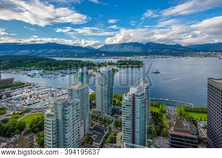 Aerial View From Downtown Vancouver At Vancouver Harbor And North Vancouver On The Opposite Shore Ag