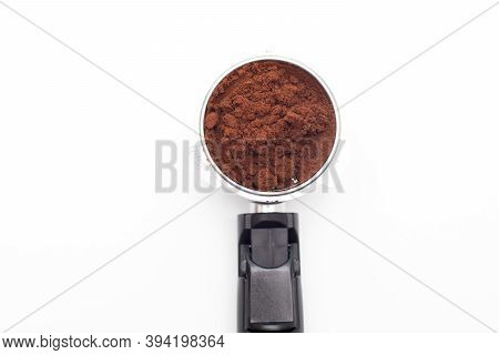 Closeup Of Metal Holder From The Coffee Machine With Ground Coffee Inside. Coffee Horn And Coffee Fi