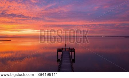Aerial View Of A Pier On Mobile Bay, Alabama At Sunset In November Of 2020