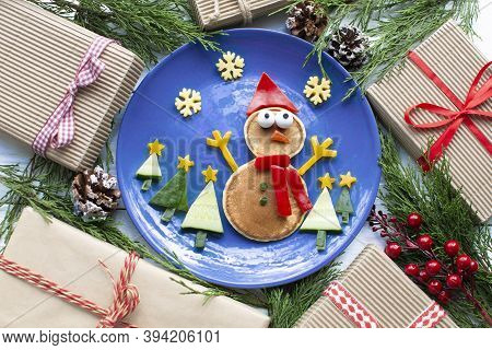 Christmas Pancake Shaped Like A Snowman With Fresh Vegetables Blue Plate On Wooden White Table Decor