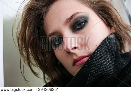 Young Woman In Coat With Dark Smoky Eyes Makeup Close Up Portrait