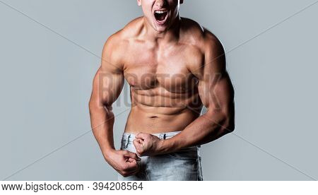 Muscular Bodybuilder Posing Over White Background. Muscular Man Screaming. Screaming Man With Well T