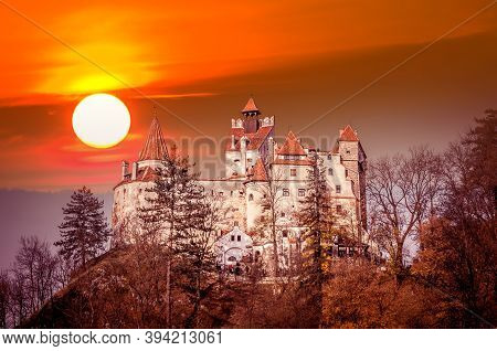 Spectacular Sunset Over Bran Castle, Transylvania, Romania. A Medieval Building Known As Castle Of D