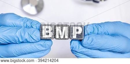 Bmp Basic Metabolic Panel - Word From Stone Blocks With Letters Holding By A Doctors Hands In Medica