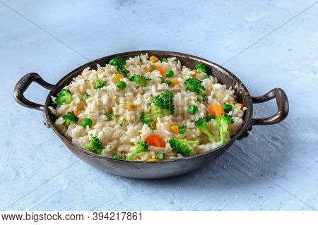 Vegan Rice With Vegetables. Broccoli, Green Peas, Carrots, A Healthy Dish