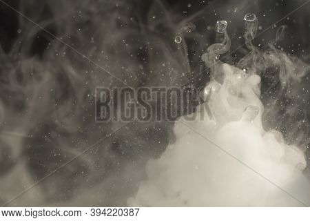 Water Drop. Chemical Reaction With Boiling Swirling Water Splashes, Jumping Drops With A Large Relea