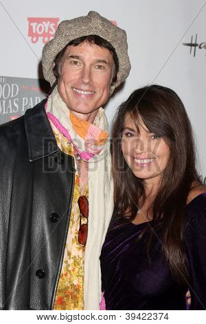 LOS ANGELES - NOV 25:  Ronn Moss, Devin DeVasquez arrives at the 2012 Hollywood Christmas Parade at Hollywood & Highland on November 25, 2012 in Los Angeles, CA