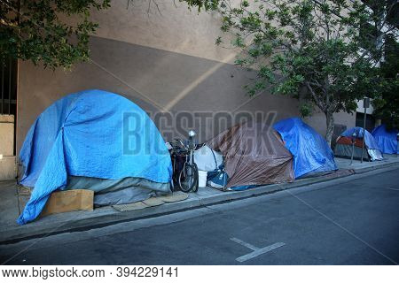 Los Angeles, California / USA - November 10, 2020: Homeless encampment on the sidewalk of Down Town Los Angeles California.   Editorial Use Only