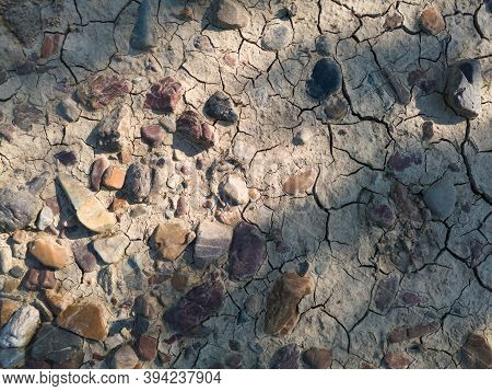 Dry Barren Lifeless Soil During Summer Heat, Soil Erosion Due To Global Warming, Pattern Of Cracks A