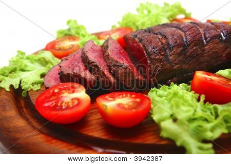 Roast Beef Red Meat On Wooden Plate
