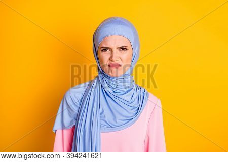 Close-up Portrait Of Attractive Displeased Capricious Muslimah Wearing Hijab Pursue Lips Isolated On