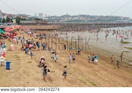 People Bathing At The Qingdao City Beach, Shandong Province, China